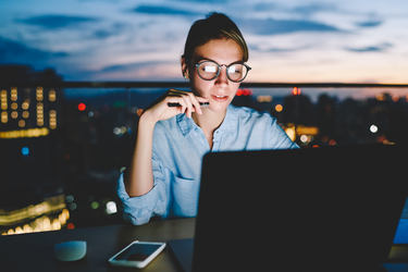 How are companies adjusting salaries for remote workers?